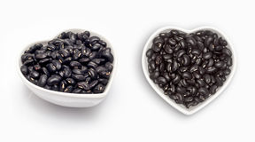 Black beans  in a heart shaped bowl Royalty Free Stock Photos