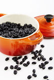 Black beans on the red pot Royalty Free Stock Photos