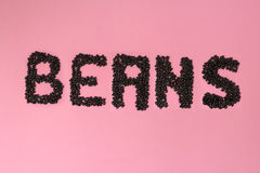 Black Beans typography. Typography made by black beans pink background Stock Photos