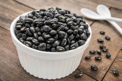 Black beans in white bowl Stock Images