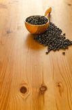 Black beans on wooden background Royalty Free Stock Photo