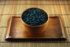 Black beans in wooden bowl Stock Images