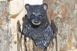 Black Bear Cub peaking out of Stump wood carving Royalty Free Stock Photography