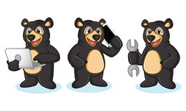 Black Bear Mascot with phone Royalty Free Stock Photo