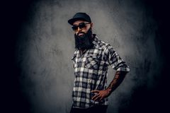 Black bearded male posing over grey background. stock photos