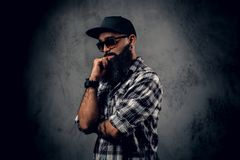 Black bearded male posing over grey background. royalty free stock photo