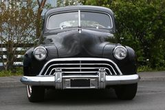 Black beast. Photograph of an old classic car in mint condition, shining chrome and highly polished finish , absolutely beautiful Stock Photo