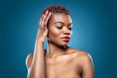 Black beautiful woman with short hair. Black beautiful woman with short spiky red hair Stock Photos