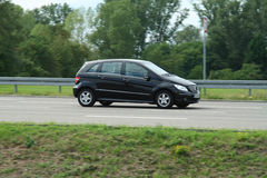 Black beauty. German Mercedes B-Class on the road Royalty Free Stock Photos