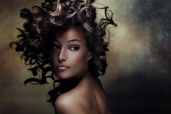 Black beauty. Beautiful black young woman beauty shot with hair in motion Stock Photo