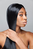 Black beauty with long straight hair Royalty Free Stock Image