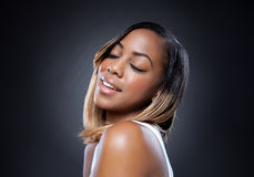 Black beauty with perfect skin smiling Stock Photos