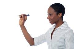 Black beauty playing darts Royalty Free Stock Photography