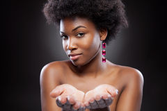 Black beauty reaching out hands. Attractive black beauty reaching out hands royalty free stock images