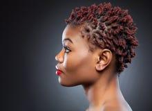 Black beauty with short spiky hair. Black beauty with short spiky red hair Stock Photo