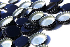 Black beer caps isolated on white Royalty Free Stock Photos