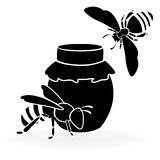 Black bees and honey Stock Photo
