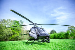 Black bell 407 helicopter getting ready to fly. Stock Image
