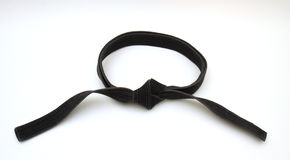 Black Belt. Used in the martial arts tied in a square knot Royalty Free Stock Photos