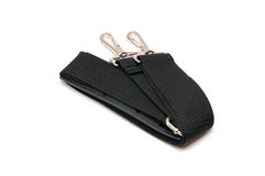 Black belt for a bag on a white background. Black belt for a bag on a white royalty free stock photos