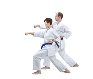 With black belt and blue belt the athletes are training punch arm Stock Photography