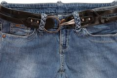 Black belt is in blue jeans Royalty Free Stock Image