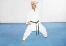 Black belt karate man in defending position Royalty Free Stock Photo