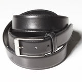 Black belt with a simple buckle on white Royalty Free Stock Photography