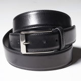 Black belt with a simple buckle on white Royalty Free Stock Photos