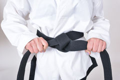 Black belt in tae kwon do athletes features Stock Images