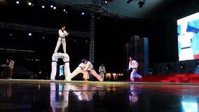 Black Belt Taekwondo breaks wooden planks in the jump. Slow motion stock video
