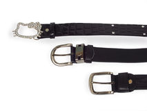 Black belts with decorative buckle. On white background Stock Photo
