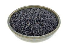 Black beluga lentils in a stoneware bowl Royalty Free Stock Photography