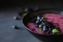 Black berries in a bowl stock photos