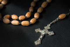 Black Bible and Crucifix with Rosary Beads Stock Photo