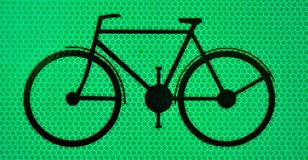 Black bicicle on a green background. With yellow reflectors , traffic sign Royalty Free Stock Photography