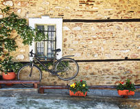 Black  bicycle against house wall Royalty Free Stock Photo