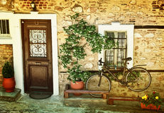 Black  bicycle against old house wall. Royalty Free Stock Photo