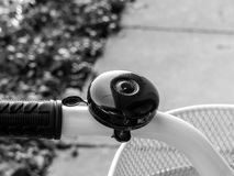 Black bicycle bell and white wheel. Women`s black bicycle bell and white wheel Stock Photography
