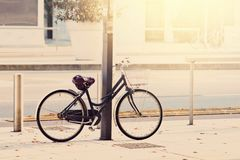 Black bicycle. Standing on the street Stock Images