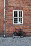 Black bicycle from an old brick wal Royalty Free Stock Image