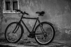Bicycle parking at the old house in black and white