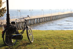 Black bicycle pier Poland Gdynia. Black bicycle at lawn and sea, pier Poland Gdynia Stock Photo