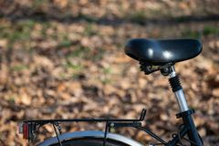 Black bicycle seat in park stock image