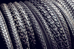 Black bicycle tires for outdoor, off-road or summer mountain bik. Black studded rubber tires for mountain, sport, extreme, off road bikes Royalty Free Stock Images