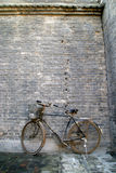 Black bicycles standing in the wall Royalty Free Stock Image