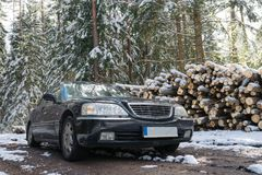 Black big car in the winter snow forest, sunny day stock photos
