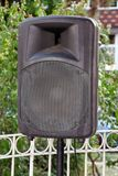 Black big speaker on stand outdoor / A big p.a. speaker on a stage at an outdoor music festival / Large audio speaker. Black big speaker on stand outdoor / A Stock Photos