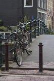 Black bike is on the bridge. In Amsterdam Stock Photography