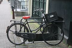 Black bike with red seat. Black bike with dotted red seat in a street in Amsterdam Stock Photography